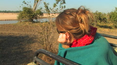 Young Woman on a Safari at the SOUTH LUANGWA NATIONAL PARK, ZAMBIA Stock Footage