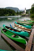 Canoes on the Lake Bohinj - stock photo