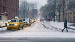 Crossing the street in a snowstorm. New York City. - stock footage