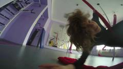 Child spinning on aerial silks Stock Footage