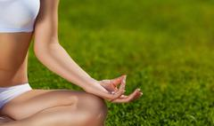 Yoga. In the lotus position on the nature of the close-up - stock photo