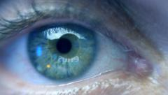 Reflection in the eye of the monitor while watching commercials. Extreme closeup - stock footage