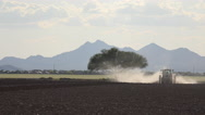 Stock Video Footage of 4K Dust Dirt Tractor Plows Farm Field Time Lapse