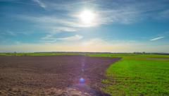 Spring field and the sun, panoramic time-lapse Stock Footage