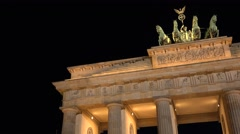 ULTRA HD 4K Pan right Brandenburg Gate Berlin landmark iconic arch night emblem  Stock Footage