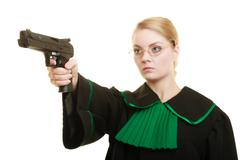 Woman lawyer with weapon gun. Crime Stock Photos