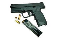 Gun with magazine and ammo - stock photo