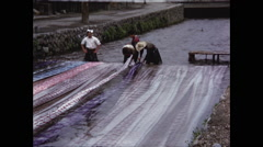 Washing Fabric in River in Kyoto 1954 Stock Footage