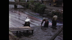 Washing Fabric in River in Kyoto 1954 reverse angle Stock Footage