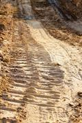 wheel track and foot print - stock photo