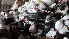 A pan of a large pile of garbage at a landfill collection site Stock Footage