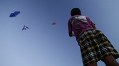 Low angle view of Indian boy kiting at beach in Goa. Stock Footage