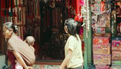 Shopkeeper waits for clients at Bhaktapur, Nepal Stock Footage
