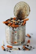 Cigarette butts in the ashtray bank Stock Photos