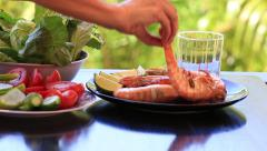 Hands decorating cooked tiger prawns with vegetables, poured red wine into glass Stock Footage