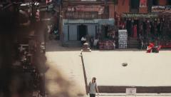 Locals and tourists pass by the Bhairavnath Temple in Bhaktapur, Nepal Stock Footage