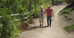 Mature married couple walking on trail - stock footage