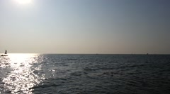 Fishing boat and first sunshine time for year 2015 - stock footage