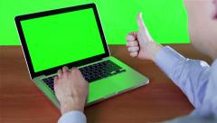 A Man Working At A Computer With A Green Screen Stock Footage