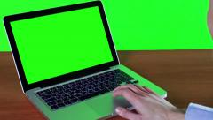 Man Working At A Computer With A Green Screen Stock Footage