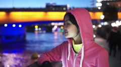 Portrait of athletic woman in the city at night Stock Footage
