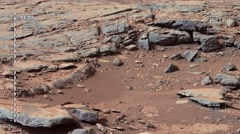 Mars surface rover scanning landscape features while panning. Arkistovideo