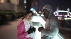 Athletic running couple in urban environment Stock Footage