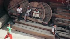 Locals rest on wooden wheels and runners in Bhaktapur, Nepal Stock Footage