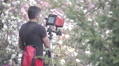Photographer takes pictures with vintage camera Stock Footage