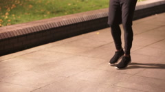 Athletic black male skipping in urban environment - stock footage