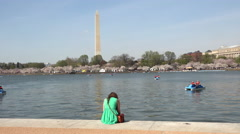 Washingtom Monument girl across water cherry blossom 4K Stock Footage