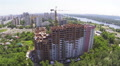 House under construction in  city, lateral flight . Aerial  Footage