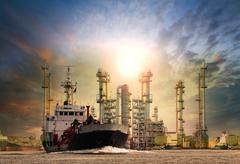 gas tanker ship and oil refinery plant background use for oil ,fuel energy an - stock photo