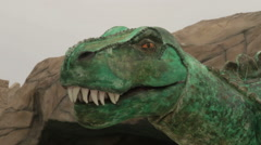 Large toy dinosaur's mouth opens Stock Footage