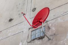 Satelite dish on the wall Kuvituskuvat