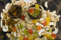 Cashew nuts and candied fruits Stock Photos