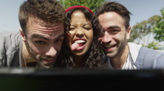 Happy carefree friends taking selfies outdoors Stock Footage