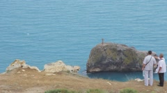 Cross on a rock in the sea Stock Footage