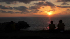 FULL SHOT. People watching the sunset in the Oaxaca coast. Stock Footage