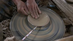 Close up hands of a man in the clay for molding clay into shape. Stock Footage