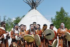 People in clothing aborigine of Kamchatka stand on background at yaranga Kuvituskuvat