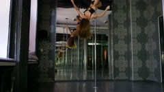 Exercises on  pole  of attractive  girl   pole dancer. 4K 3840x2160 Stock Footage