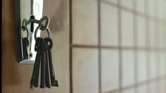 Keys hanging on door Stock Footage
