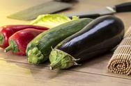 Stock Photo of still life with eggplant, zucchini and red bellpepper