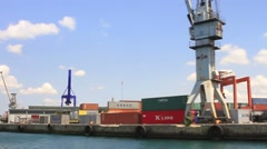 Cargo port in shipyards in clear weather on a background of blue sky Stock Footage