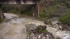 Stock Video Footage of Creek along Road under Bridge 1