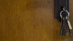 Keys hanging on door Stock Footage