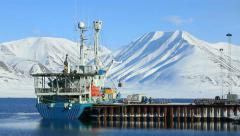 Loading cargo on a cargo ship in port on Svalbard. Stock Footage