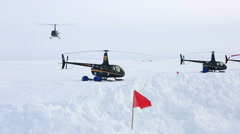 "Helicopters ""Robinson"" Landed in the snow. - stock footage"