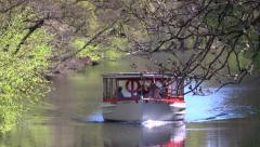 A tour boat on the mill stream (Mølleåen) Stock Footage